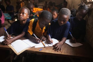 Sierra Leone after Taylor: Students share a desk during a mathematics class at a private school