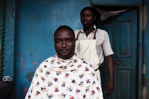 Sierra Leone after Taylor: A man has his weekly haircut in the city of Makeni