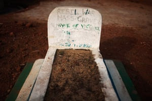 Sierra Leone after Taylor: A headstone marks a mass grave of rebel victims in the village of Bomaru