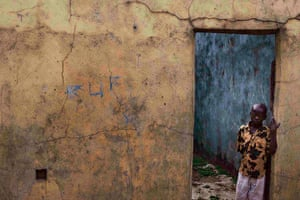 Sierra Leone after Taylor: Boy stands in abandoned home damaged during 1991-2002 civil war