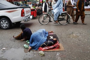 Picture Desk Live: An Afghan woman beggar sleeps on the street