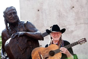 The week in music: Singer Willie Nelson poses beside a statue of himself in Austin