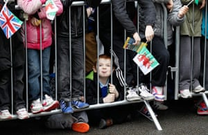 Picture Desk Live: A boy pokes out his tongue while waiting for the Queen