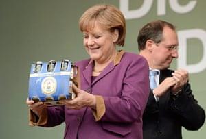 Picture Desk Live: German Chancellor Merkel smiles after she received beer