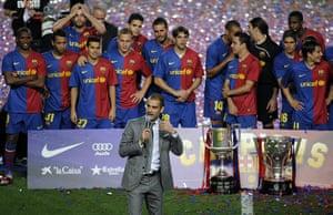 Guardiola resigns: Barcelona's coach Pep Guardiola (C, down