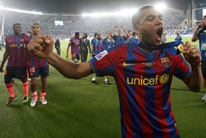 Guardiola resigns: Barcelona's Dani Alves celebrates with h