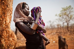 Picture desk live: A woman and her child wait to register outside the Yida refugee camp