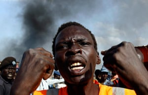 South Sudan: A man gestures at a market burnt in an air strike by the Sudanese air force