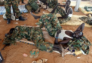 South Sudan: South Sudan's SPLA soldiers rest near an oil field in Unity State