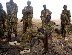South Sudan: A South Sudan's army commander sits in a chair in Panakuach, Unity state