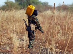 South Sudan: Soldier carries water to his position on the frontline in Panakuach