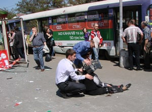 Picture desk live: People assist an injured woman at the scene of an explosion in Ukraine