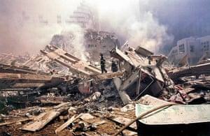 World Trade Centre: 11 September 2001: Firemen walk around Ground Zero