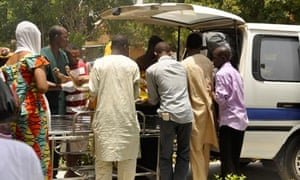 Officials remove the body of a shooting victim in Kano, Nigeria 29/4/12