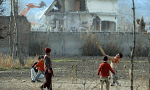Young boys play cricket beside Bin Laden compound remains 26/2/12