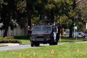 Oakland shooting: Police officers on an armoured vehicle survey the scene of a shooting