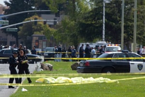 Oakland shooting: Oakland Police crime scene investigators stand over a number of bodies