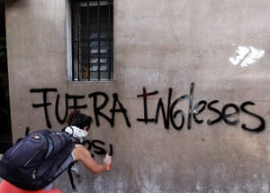 Falklands protests: A demonstrator spray paints a graffiti during a demonstration, Buenos Aires