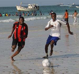 Somalia: Boys play football near the Lido beach