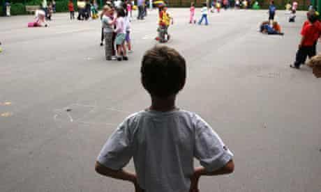 Child alone in school playground