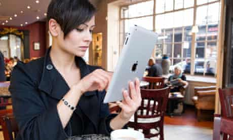 Young woman browsing the Internet on an Apple iPad