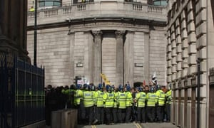 Riot police hold protesters