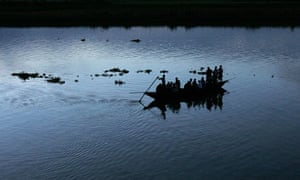 Indian commuters cross the Brahmaputra river, where a ferry carrying 350 passengers has capsized