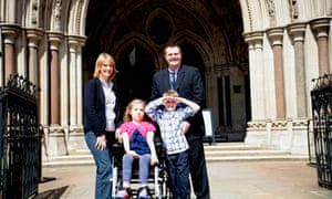 Milly Evans, 11, outside the high court with her family