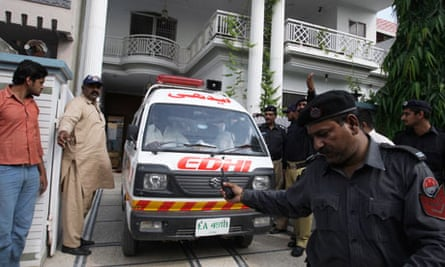 An ambulance removes the bodies of the widow and mother-in-law of Pakistani man killed by CIA worker