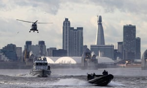 Police and Royal Marines perform a joint exercise ahead of the London 2012 Olympics