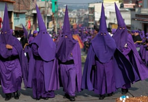 Holy Week: Men dressed for the procession of the statue of Jesus