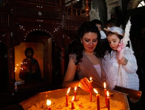 Holy Week: A woman holds a lit candle