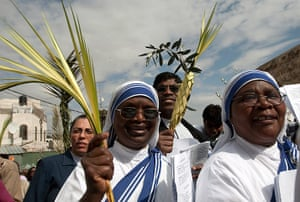 Holy Week: Catholic nuns march during the traditional Palm Sunday procession