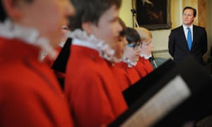 David Cameron listens to the Westminster Abbey boys' choir at an Easter reception at Downing Street