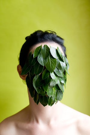 Getty gallery: Woman's face covered with leaves