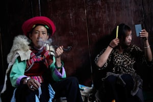 FTA: How Hwee Young: A veteran performer of the Naxi ethnic minority smokes her pipe backstage