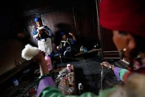 FTA: How Hwee Young: Performers spin cotton in the traditional way in a room backstage