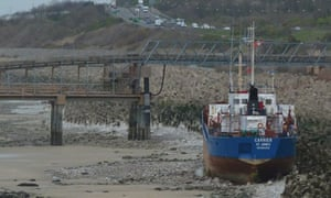 The stricken cargo ship Carrier sits on the beach at Llanddulas in north Wales
