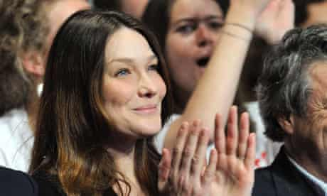 Carla Bruni listens to her husband Nicolas Sarkozy address a rally of UMP party in Paris.
