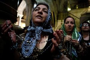 Easter:  Catholic pilgrims pray during the Holy Thursday mass