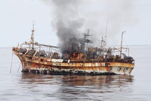 Ryou-Un Maru: A plume of smoke rises from the derelict Japanese ship Ryou-Un Maru