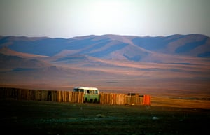 24 hours: Mogolia: An old Russian-made van sits in a yard in a small mining camp