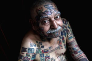 24 hours: New Delhi, India: Har Parkash who has 200 flags tattooed on his body