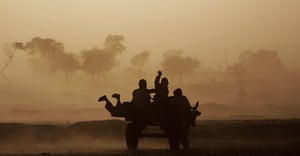 24 hours: Islamabad, Pakistan: Children riding on a donkey cart caught in a sandstorm