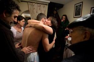 24 hours: Valverde De La Vera, Spain: A man is comforted after he was tied to cross