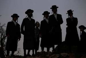 24 hours: Jerusalem: Ultra-Orthodox Jews watch others collecting spring water