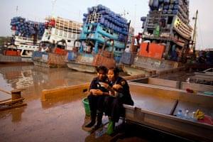 24 hours: Rangoon, Burma: Women take a break at the Annawa fish market and seaport