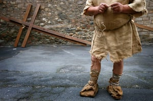 Good Friday traditions: Bensheim, Germany: A man waits to take part in a re-enactment