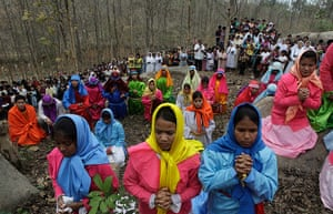 Good Friday traditions: Gauhati, India: Devotees offer prayers during a re-enactment of crucifixion