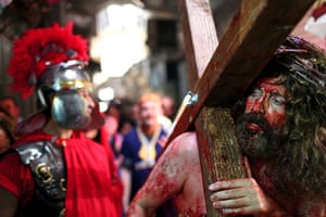 Good Friday traditions: Jerusalem: An actor representing Jesus Christ carries a cross